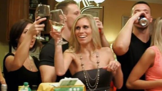 "A&E's ""Neighbors With Benefits"" featured Diana McCollister of Hamilton Township, Ohio, in front with white wine glass, and her husband, Tony, behind her, but was canceled after two episodes."
