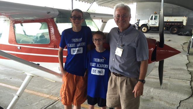 Rex Damschroder stands with two of his Youth Flight Camp members.