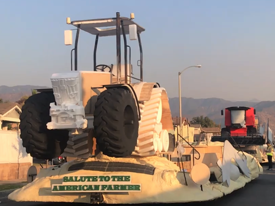 Workers take the Ag PhD Rose Parade float out for a