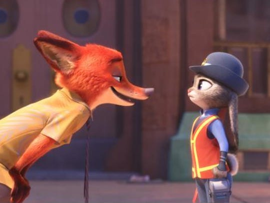 """Officer Judy Hopps (voice of Ginnifer Goodwin) meets a scam-artist fox (voiced by Jason Bateman) in """"Zootopia,"""" opening in theaters March 4."""
