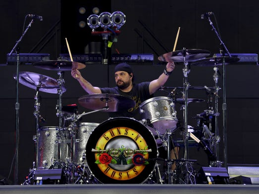 Imy James, a drum tech for Guns N' Roses, tunes up