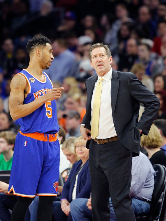 New York Knicks guard Courtney Lee (5) talks with head coach Jeff Hornacek during the first half of an NBA basketball game against the Detroit Pistons, Saturday, March 11, 2017, in Auburn Hills, Mich. (AP Photo/Carlos Osorio)