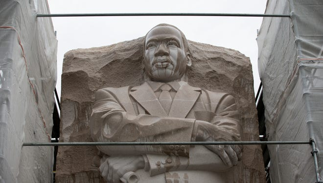 Scaffolding surrounds the Martin Luther King Jr. Memorial on a rainy day in Washington.