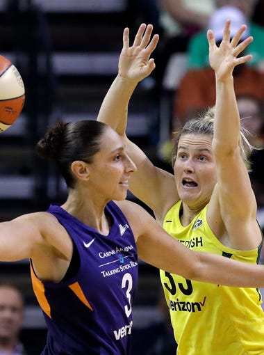 Seattle Storm's Sami Whitcomb, right, defends against Phoenix Mercury's Diana Taurasi during the first half of Game 5 of a WNBA basketball playoffs semifinal, Tuesday, Sept. 4, 2018, in Seattle.