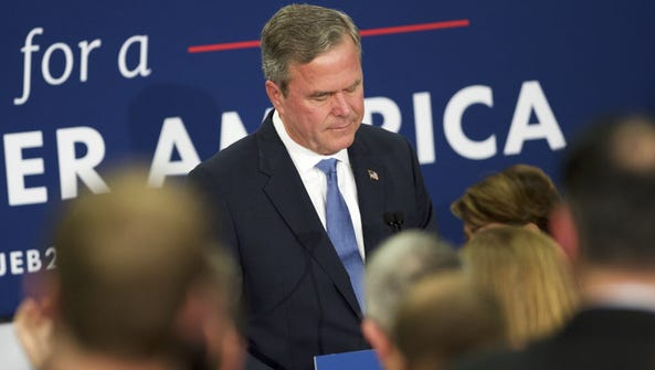 Jeb Bush reacts as he announces the suspension of his