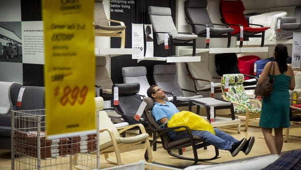 A shopper tries out a chair at an Ikea store in the