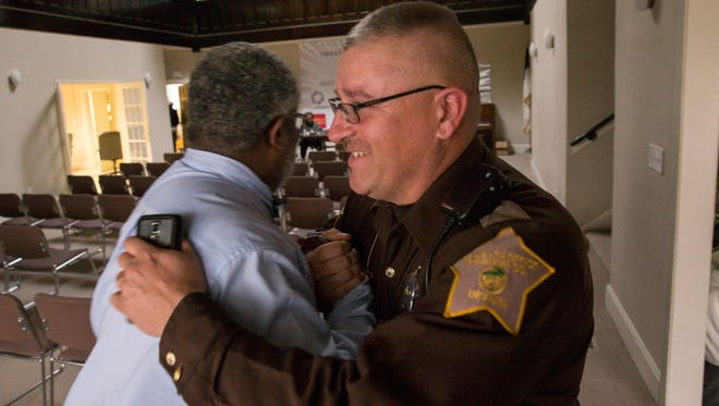Jerome Johnson (left), an assistant pastor at First Baptist Church North, Indianapolis, and D.J. Nuetzmann, a Sheriff's Deputy from Martinsville, have formed a friendship over their love of God, and fishing, Indianapolis, Thursday, February 23, 2017.