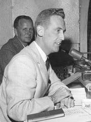 Vin Scully (foreground) and Jerry Doggett call a Dodgers game in the 1950s.