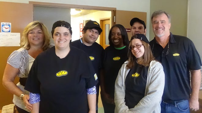 Civitan's Dawn Trapp (left) joins Which Wich? workers (from left) Becky Warren, Adil Malik, Yvonne Griffen, Lynn Childres (back), Sarah Konopka and owner Peter Green.