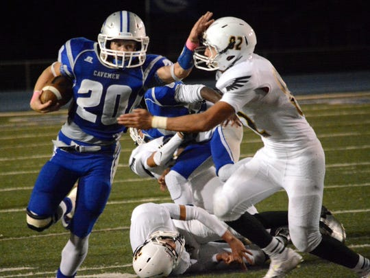 Carlsbad senior running back Luke Wood fights off Hobbs