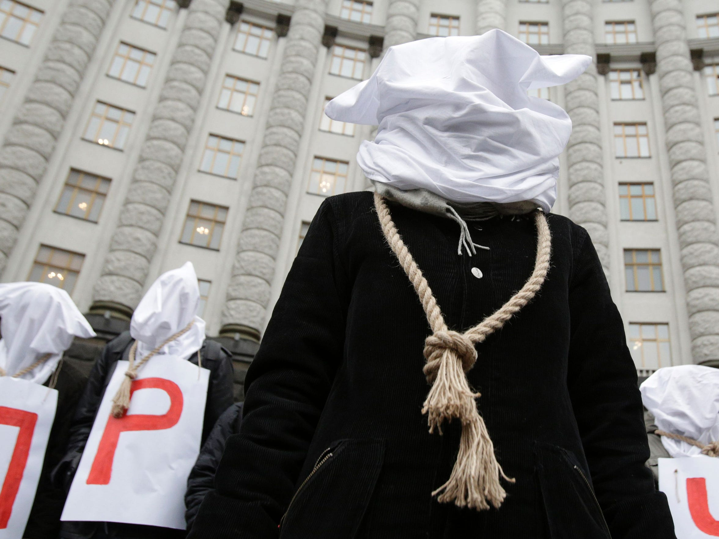 HIV/AIDS activists with the group 100% Life protest in front of a government building in Kyiv, Ukraine, in 2016 after a draft budget proposed cutting funding for drug procurement.