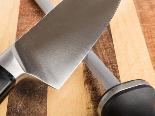 Kitchen knife and sharpening steel.