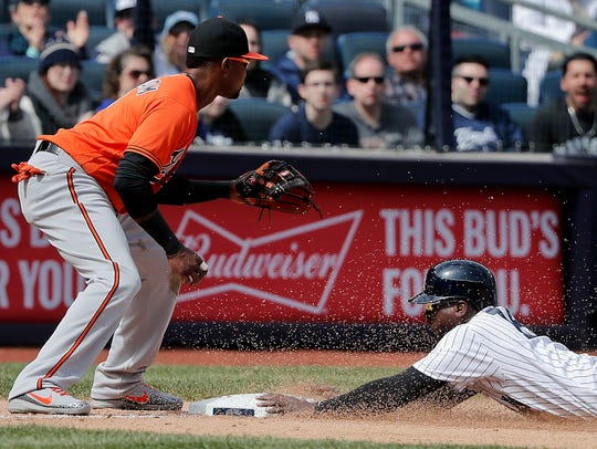 New York Yankees' Didi Gregorius, right, slides safely