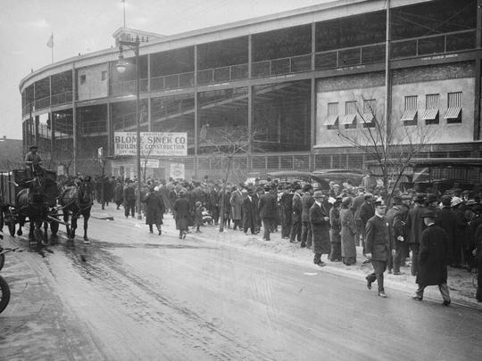 This May 14, 1914, photo shows crowds lining up outside Weeghman Park in Chicago. The park was renamed Wrigley Field in 1927.