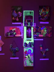 The exhibition's iridescent layout is akin to the arrangement of religious art and iconography.