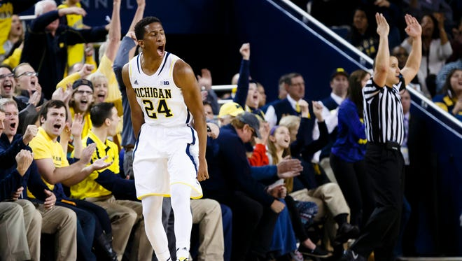 Michigan Wolverines guard/forward Aubrey Dawkins (24) celebrates a three point basket in overtime against the Illinois Fighting Illini at Crisler Center. Michigan won 73-65 in overtime.