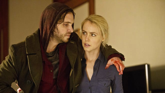 "Aaron Stanford is Cole and Amanda Schull is Railly in the SyFy television series ""12 Monkeys."""