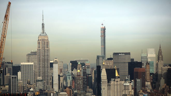 The Empire State building and the skyline of Manhattan.