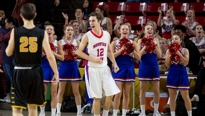 Mountain View's  Tommy Kuhse celebrates a three-pointer during the boys basketball quarterfinals at Wells Fargo Arena, February 25, 2015 in Tempe.