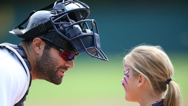 Alex Avila of the Detroit Tigers greets a young Tigers fan on Sept. 14, 2014.