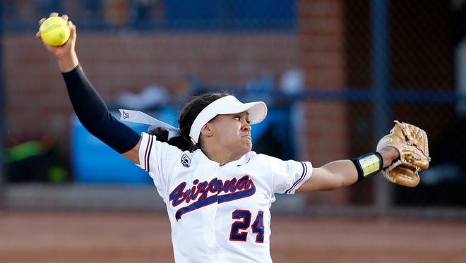 Arizona pitcher Trish Parks throws in the first inning during an NCAA college softball tournament regional championship game against Minnesota, Sunday, May 17, 2015, in Tucson, Ariz.