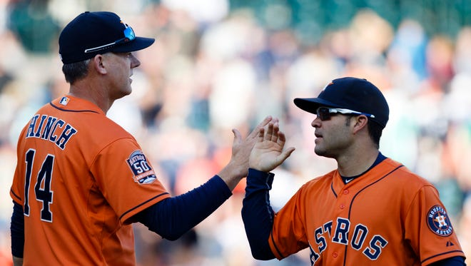 Astros manager A.J. Hinch and second baseman Jose Altuve celebrate after the game.