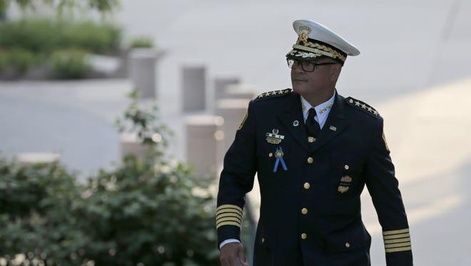 Cincinnati Police Chief Jeffery Blackwell exits following the visitation.