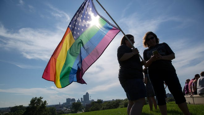 Adrienne Erazo (left) and Allison Martens, both of Ankeny, talk while waiting for speakers to begin Friday, June 26, 2015, during a rally to celebrate the Supreme Court decision upholding gay marriage on the grounds of the Iowa Supreme Court in Des Moines.