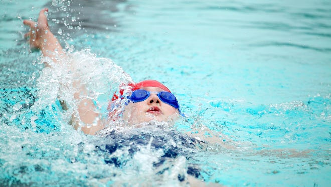 Julia Smith, 10, competes in the 100-meter backstroke event with the Shenandoah Marlins Aquatic Club team at the Commonwealth Games of Virginia at War Memorial Pool at Ridgeview Park in Waynesboro on Saturday, June 27, 2015.