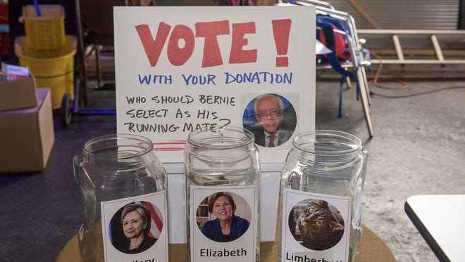 Vote with your dollar jars to help Bernie Sanders choose a running mate include Limberbutt McCubbin, the cat from Louisville that's officially registered with the Federal Election Commission as a candidate for president as an option at the first rally held by the Kentucky for Bernie Sanders group at the Tim Faulkner Gallery in Portland. July 12, 2015