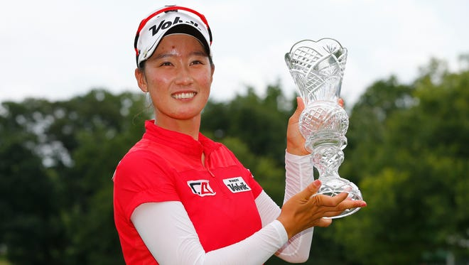 Chella Choi holds the Marathon Classic trophy Sunday at Highland Meadows.