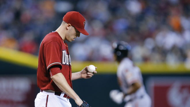 Arizona Diamondbacks starting pitcher Patrick Corbin (46) reacts after giving up a solo home-run to San Francisco Giants'  Justin Maxwell (43) in the 2nd inning of their MLB game Sunday, July 19, 2015 in Phoenix, Ariz.
