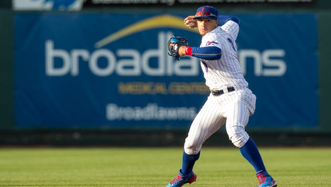 Iowa Cubs' Javier Baez (9) throws the ball to first Tuesday, May 12, 2015, during their game at Principal Park in Des Moines.