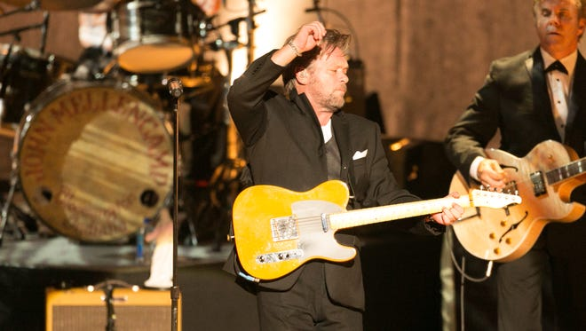 John Mellencamp performs at the Comerica Theatre, Wednesday, July 28, 2015, in Phoenix, Ariz.