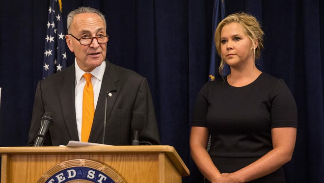 Comedian Amy Schumer (R) and U.S. Senator Chuck Schumer (D-NY) speak at a press conference calling for tighter gun laws in an effort to stop mass shootings and gun violence on August 3, 2015 in New York City.