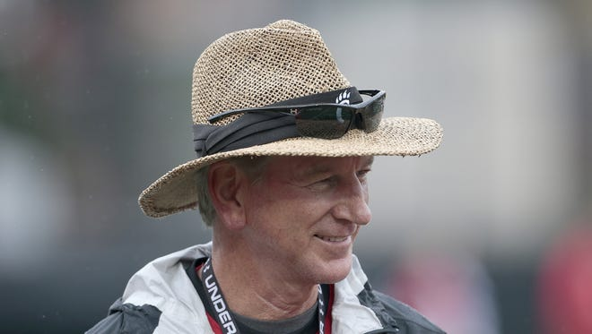 Head coach Tommy Tuberville smiles as he heads to the sideline during practice at the The Sheakley Athletics Center on the campus of the University of Cincinnati, on Thursday, Aug. 6, 2015.