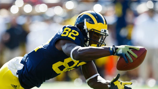 Sep 13, 2014; Michigan Wolverines wide receiver Amara Darboh (82) dives score a touchdown in the first quarter against the Miami (Oh) Redhawks at Michigan Stadium.
