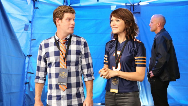 Stephen Rannazzisi. left, and Katie Aselton star in FXX's 'The League.'