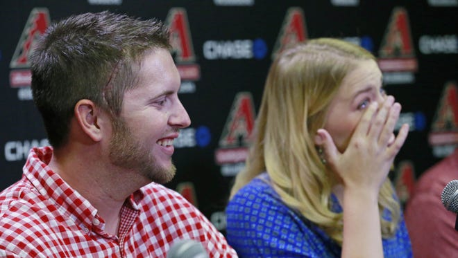 Arizona Diamondbacks pitcher Evan Marshall with his wife, Allie, returns to Chase Field Tuesday, August 25, 2015 in Phoenix, Ariz. Marshall returned for the first time since taking a line drive to the head earlier this month playing for Triple-A Reno.