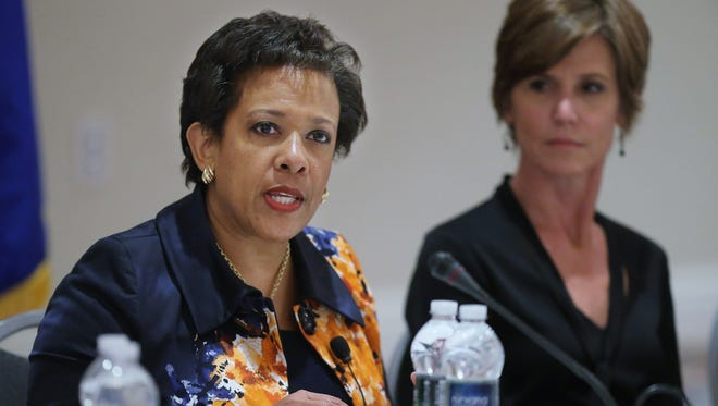 Attorney General Loretta Lynch delivers closing remarks to the Justice Department Summit on Violence Crime Reduction in Washington on Oct. 7, 2015, as Deputy Attorney General Sally Yates looks on.