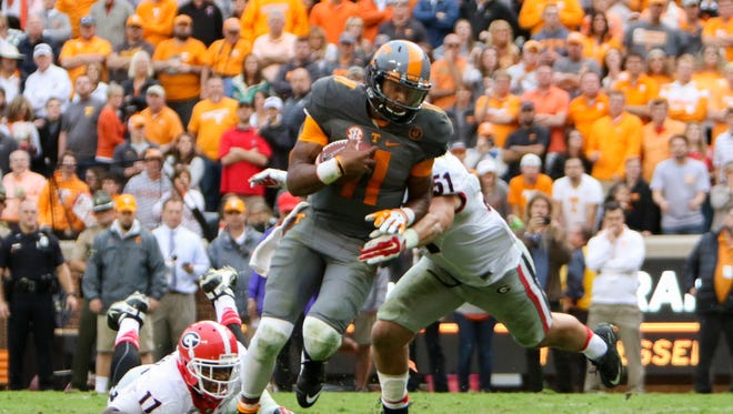 Tennessee Volunteers quarterback Joshua Dobbs (11) runs for a touchdown against the Georgia Bulldogs during the second half at Neyland Stadium.