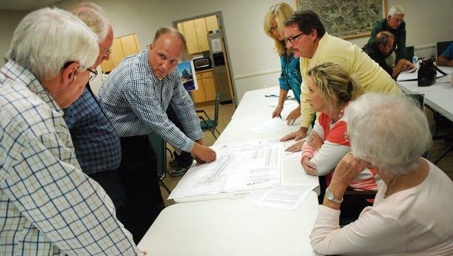 Orco's Vice President of Land Development Jesse Kranz, (third on left) answers questions from residents about the proposed Buchanan Estates subdivision at Shackle Island Volunteer Fire Department on Wednesday in Hendersonville.