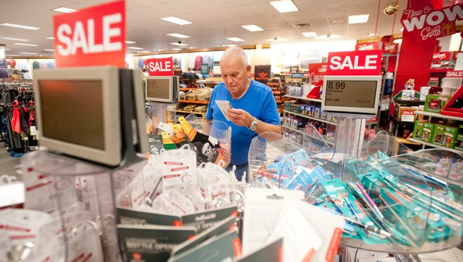 Jesse Bright of Pleasure Ridge Park looks around at Kohl's for little items he can use as his wife shops elsewhere in the store.
