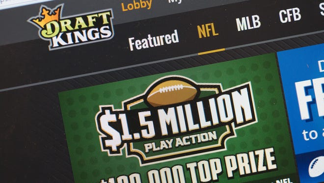 The fantasy sports web site DraftKings is shown. DraftKings and its rival FanDuel are seeking a temporary restraining order in New York.