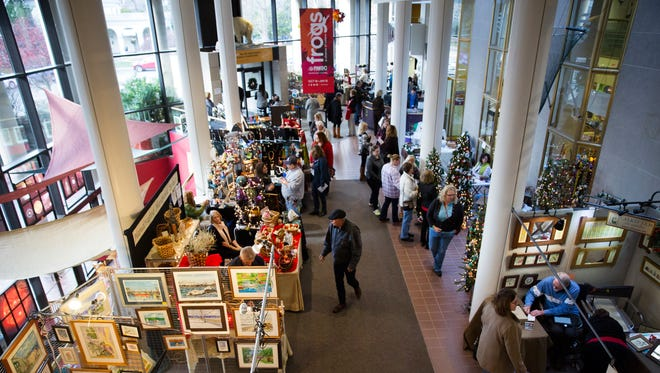 Shoppers look around the Holiday Bazaar at the Rochester Museum and Science Center on Sunday, November 22, 2015.