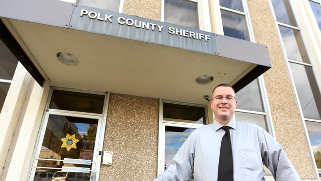 Sgt. Mark Garton stands outside the Polk County Sheriffs Office in October.