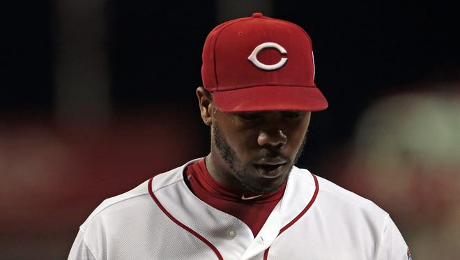 Reds closer Aroldis Chapman hangs his head as he leaves the field after giving up the go-ahead run against the Cubs on July 22.