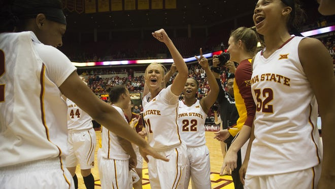 Iowa State's Jadda Buckley, TeeTee Starks, Meredith Burkhall and other members of the Cyclone women's basketball team celebrate after defeating the University of Iowa 69-66 during the CyHawk women's basketball game at Hilton Coliseum in Ames, Friday, Dec. 11, 2015.