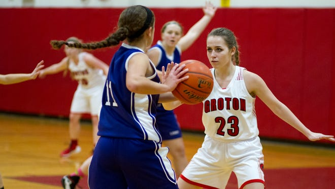 Dryden sophomore guard Grace Depaull looks for an open teammate while defended by Groton's Denielle Breeds in the first quarter of Tuesday night's game at Groton. Dryden won, 52-36.