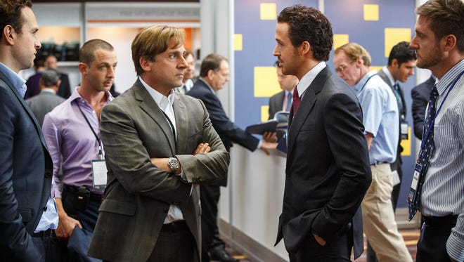 "This photo provided by Paramount Pictures shows, Rafe Spall, from left, as Danny Moses, Jeremy Strong as Vinnie Daniel, Steve Carell as Mark Baum, Ryan Gosling as Jared Vennett and Jeffry Griffin as Chris, in the film, ""The Big Short,"" from Paramount Pictures and Regency Enterprises."